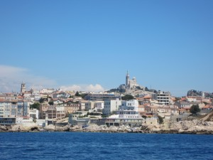 Notre Dame de la Garde is on the hill top and  dedicated to sailors