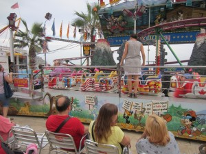 Carnival ride at Blanes.  Nice consideration to have chairs for the parents as they watch their children.