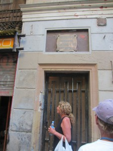 Ceca outside the door to their new flat in Barcelona